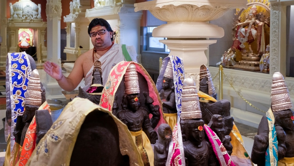Leah Hogsten   The Salt Lake Tribune Sri Ganesha Hindu Temple priest Sathish Nivarthi makes offerings to the planets of the Navagraha shrine, March 28, 2019. Hindu priests act as a kind of mediator between the worshipper and the deity, performing rituals to the deities on behalf of the worshippers. Artisans from around the world spent two years hand-carving deities in the Sri Ganesha Hindu Temple in South Jordan.