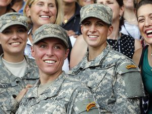 (John Bazemore   AP file photo) Army 1st Lt. Shaye Haver, center, and Capt. Kristen Griest, right, pose for photos with other female West Point alumni after an Army Ranger school graduation ceremony at Fort Benning, Ga., in 2015. Haver and Griest became the first female graduates of the Army's rigorous Ranger School.