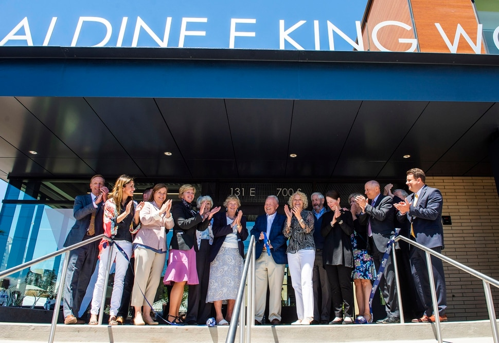 (Rick Egan | The Salt Lake Tribune) Pat King cuts the ribbon at the Geraldine E. King Women's Resource Center, one of three new shelters that will replace the Road Home. Friday, June 21, 2019.