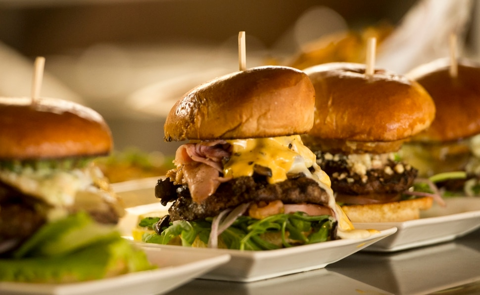 (Rick Egan | The Salt Lake Tribune) The Frenchy burger (center), topped with ham, brie and caramelized mushrooms, at Fat Jack's Burger Emporium & Tap House, attached to the new Holiday Inn Express on West Temple in Salt Lake City.