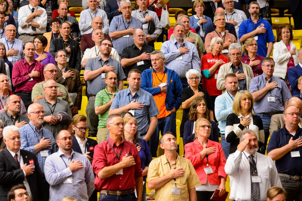 (Trent Nelson | Tribune file photo) Delegates during the national anthem at the Utah Republican Party's 2019 Organizing Convention at Utah Valley University in Orem on Saturday May 4, 2019.