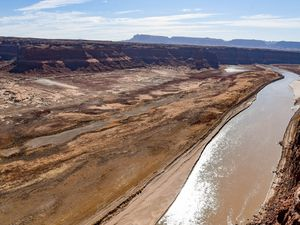 (Francisco Kjolseth  | The Salt Lake Tribune) The Hite Marina boat ramp sits idle hundreds of yards from the river's edge where the Colorado River flows into Lake Powell on Thursday, Feb. 4, 2021. Utah plans to fill the Lake Powell pipeline with water promised to the Ute Indian Tribe. The Utes say it continues decades of racially based maneuvers.