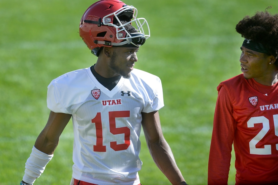 Scott Sommerdorf | The Salt Lake Tribune Utah QB Jason Shelley, left, talks with WR Jaylen Dixon after the first day of Utah fall football camp, Friday, July 28, 2017.