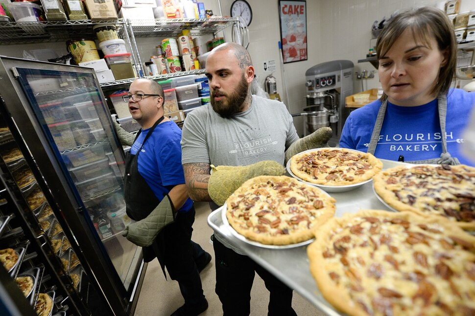 (Francisco Kjolseth | The Salt Lake Tribune) Dennis Sisneros, left, an intern at Flourish Bakery joins A.J. Collette, head of operations, and Executive Director Aimee Altizer prepare a large order of pies before the Thanksgiving holiday. The non-profit bakery teaches those who have been incarcerated or recovering from substance abuse the art of baking. The skills they learn help them get a job and become financially independent. The bakery has been housed at SLCC's South City campus, but the college has said they can no longer use the space.