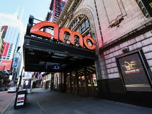(Evan Agostini/Invision | AP file photo) AMC Empire 25 theatre appears on 42nd Street in New York. The nation's largest movie theater chain changed its position on mask-wearing less than a day after the company became a target on social media for saying it would defer to local governments on the issue. AMC Theaters CEO Adam Aron said Friday that its theaters will require patrons to wear masks upon reopening, which will begin in July.