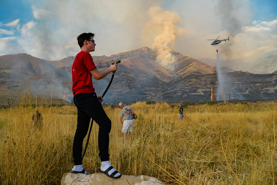 (Francisco Kjolseth | Tribune file photo) Crews battle a grass fire in Tooele County in 2019.