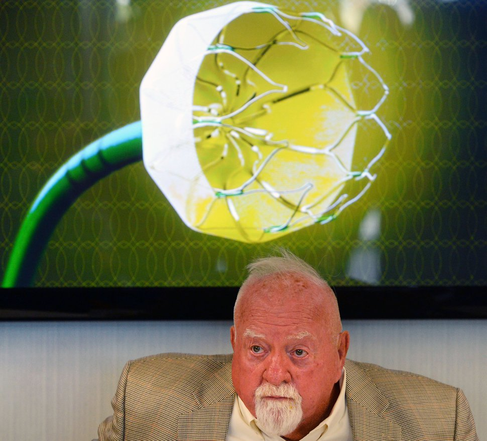 (Steve Griffin | Tribune file photo) Device recipient Wilford Brimley talks in 2016 about the Watchman left atrial appendage closure device, back, a life-saving and heart-preserving cardiac device that has been tested extensively in clinical trials by scientists and cardiologists at the Intermountain Medical Center Heart Institute in Murray.