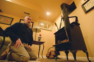 (Steve Griffin | Tribune file photo) Sugar House resident Scott Thomas, shown with his clean-burning Lipo Parlor wood stove in 2015. The U.S. Environmental Protection Agency announced Wednesday that Utah will receive nearly $13 million for Provo, Salt Lake City and Logan, to fund exchange programs for inefficient wood-burning devices and take other steps in hopes of improving air quality.