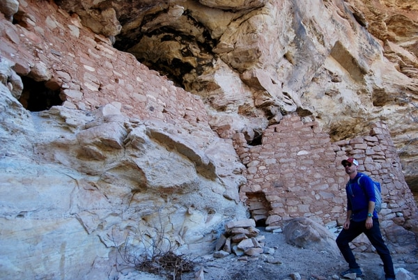(Brian Maffly | The Salt Lake Tribune) Josh Ewing, executive director of Friends of Cedar Mesa, explores an alcove in Jenny Canyon, a tributary of Recapture Canyon east of Blanding, where Anasazi cliff dwellings like this one remain hidden in the canyon walls. The Bureau of Land Management has issued numerous new oil and gas leases in an area that is blanketed with artifacts — over the objections of historic preservation groups that fear the BLM lacks sufficient information about thousands of cultural sites to ensure their protection.