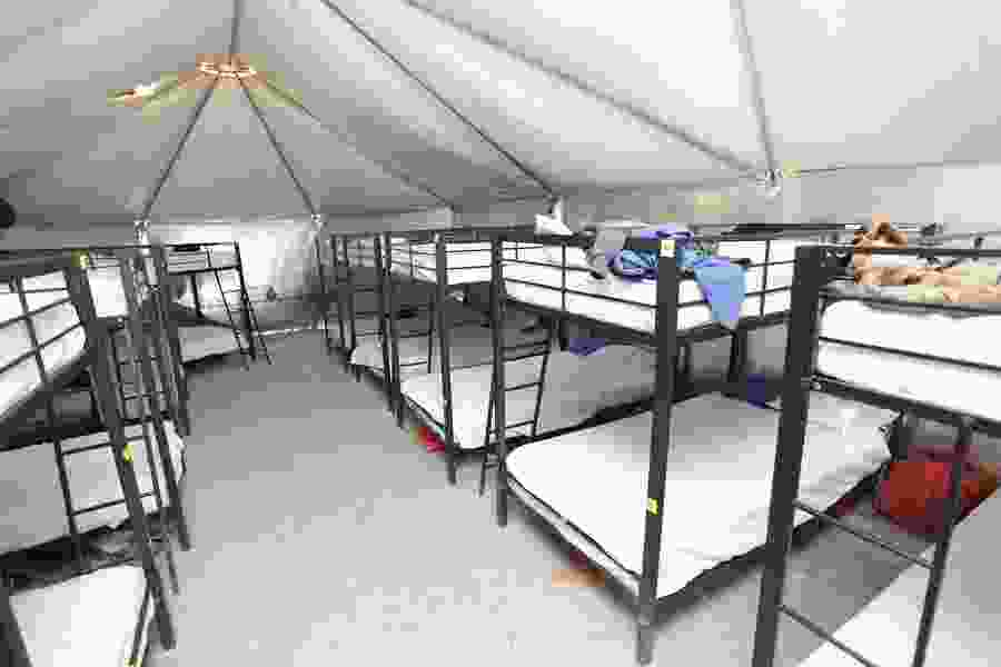 In a vast tent complex, about 1,500 undocumented minors await sponsors