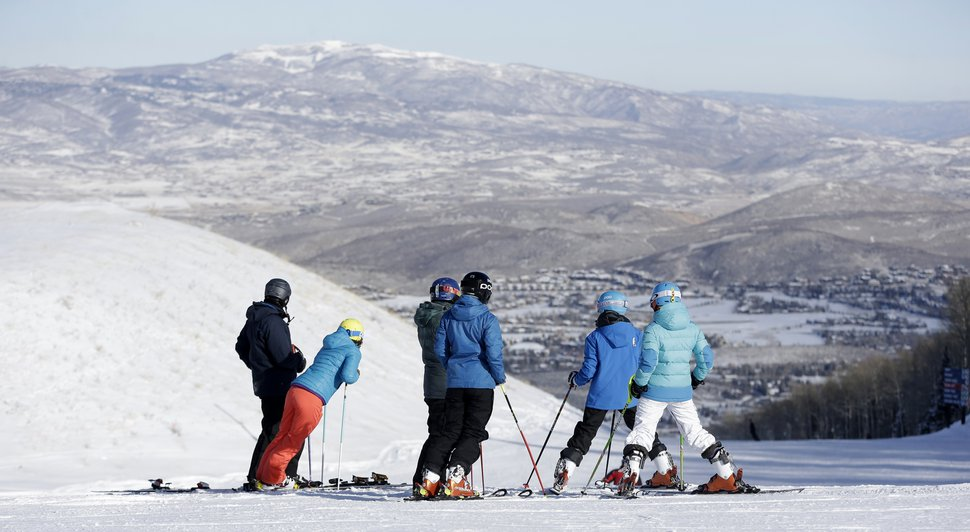 FILE - In this Nov. 23, 2013, file photo, skiers at Park City Mountain Resort stand on top of a hill, in Park City, Utah. Vail Resorts Inc. is announcing plans to build a high-speed gondola this summer that would connect its newly acquired Utah ski resort to another it owns to create what the company says will be the largest ski area in the United States. Vail announced the connecting lift plans Monday, Dec. 8, 2014, as part of $50 million in investments at Park City Mountain Resort and Canyons Resort. (AP Photo/Rick Bowmer, File)