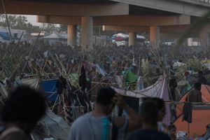 (Veronica G. Cardenas   The New York Times)  People seeking asylum at a makeshift camp near the Del Rio International Bridge as they wait to turn themselves in to Border Patrol agents in Del Rio, Texas on Friday, Sept. 17, 2021. The temporary camp in Del Rio has grown with staggering speed in recent days during a massive surge in migration that has overwhelmed the authorities.