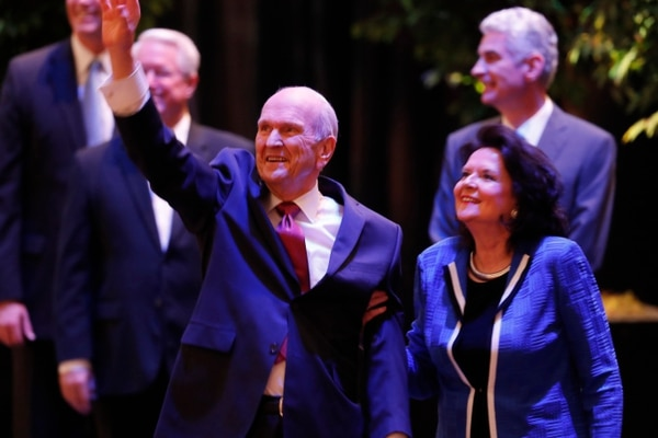 (Courtesy LDS Church) President Russell M. Nelson, with his wife, Wendy, waves to the Latter-day Saint youths, 21,000 of them, in the Conference Center. Thousands of other youths from around the world listened to the leader's counsel during a devotional Sunday, June 3, 2018.
