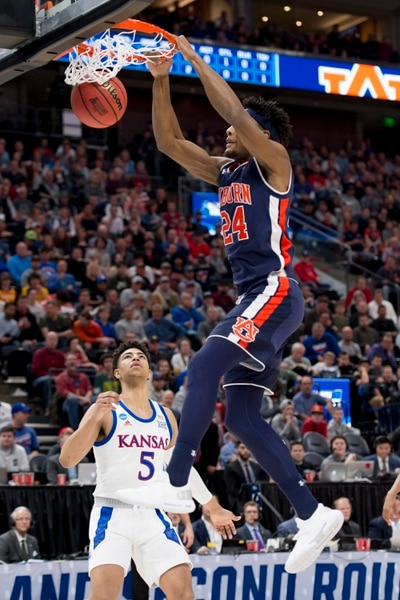 (Leah Hogsten | The Salt Lake Tribune) Auburn Tigers forward Anfernee McLemore (24) dunks over Kansas Jayhawks guard Quentin Grimes (5) as Auburn faces Kansas in the second round of the NCAA tournament in Salt Lake City on Saturday, March 23, 2019.