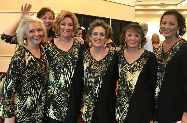 (Photo courtesy of Kathie Allen) Kathie Allen (left) poses for a picture with members of her Sweet Adelines chorus.