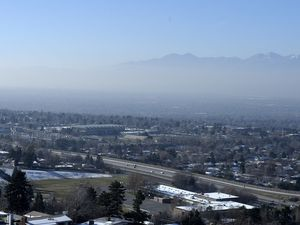 (Al Hartmann  |  The Salt Lake Tribune) 	 View diminishes as one looks from the east foothills above I-215 into the mid part of the Salt Lake Valley Friday.