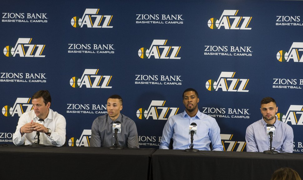 (Rick Egan | The Salt Lake Tribune) Dennis Lindsey talks about the re-signed free agents, Dante Exum, Derrick Favors and Raul Neto, at the Jazz practice facility, Friday, July 6, 2018.