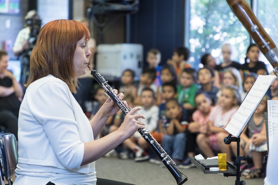(Courtesy Marc Estabrook/Utah Symphony) Lissa Stolz plays the oboe for students at Springdale Elementary during a stop on the Utah Symphony's Great American Road Trip on Tuesday, Aug. 29.