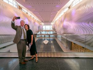 (Trent Nelson     The Salt Lake Tribune) Larry and Tammy Pinnock take a selfie with The Canyon, an art installation at the new Salt Lake City International Airport on Thursday, Aug. 27, 2020.