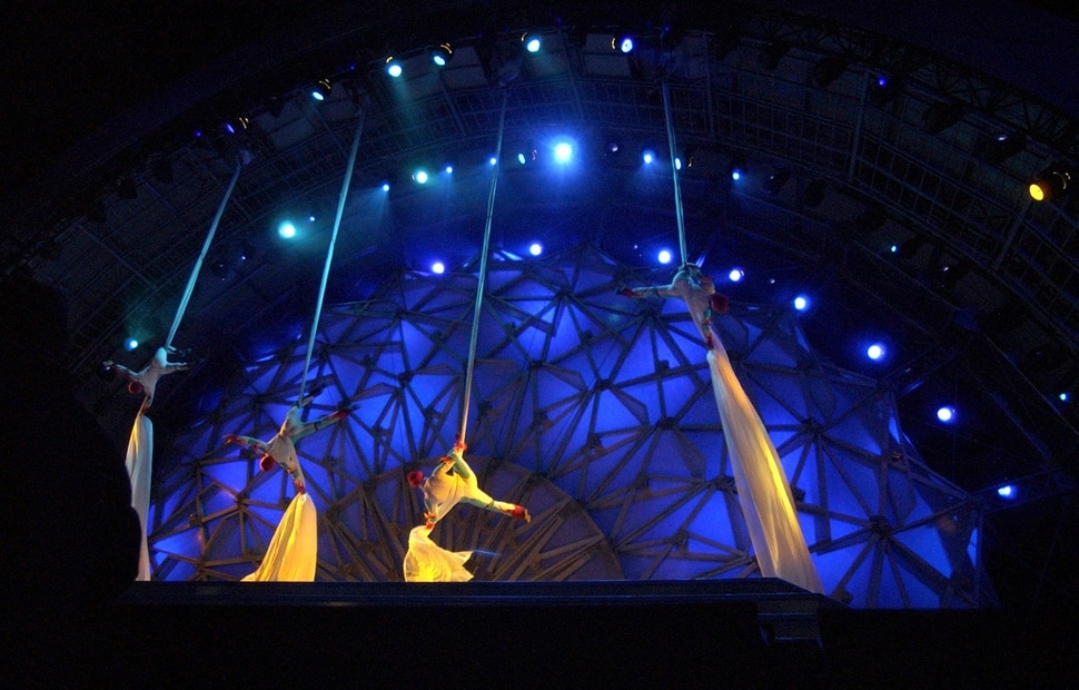 (Steve Griffin | Tribune file photo) Acrobats slide down long pieces of material onto the stage at the Olympic Medals Plaza during kicking off the first night of activities in downtown Salt Lake City Feb. 9, 2002. The first medalists of the 2002 Olympics received their medals and the Dave Mathews Band performed.