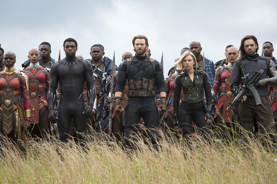 This image released by Marvel Studios shows, front row from left, Danai Gurira, Chadwick Boseman, Chris Evans, Scarlet Johansson and Sebastian Stan in a scene from Avengers: Infinity War, premiering on April 27. (Chuck Zlotnick/Marvel Studios via AP)