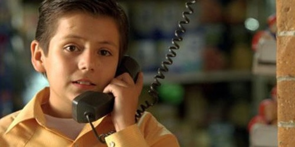 (courtesy Fox Searchlight Pictures) Carlos (Adrian Alonso), a 9-year-old Mexican boy, talks to his mother in America, in the 2007 drama Under the Same Moon.