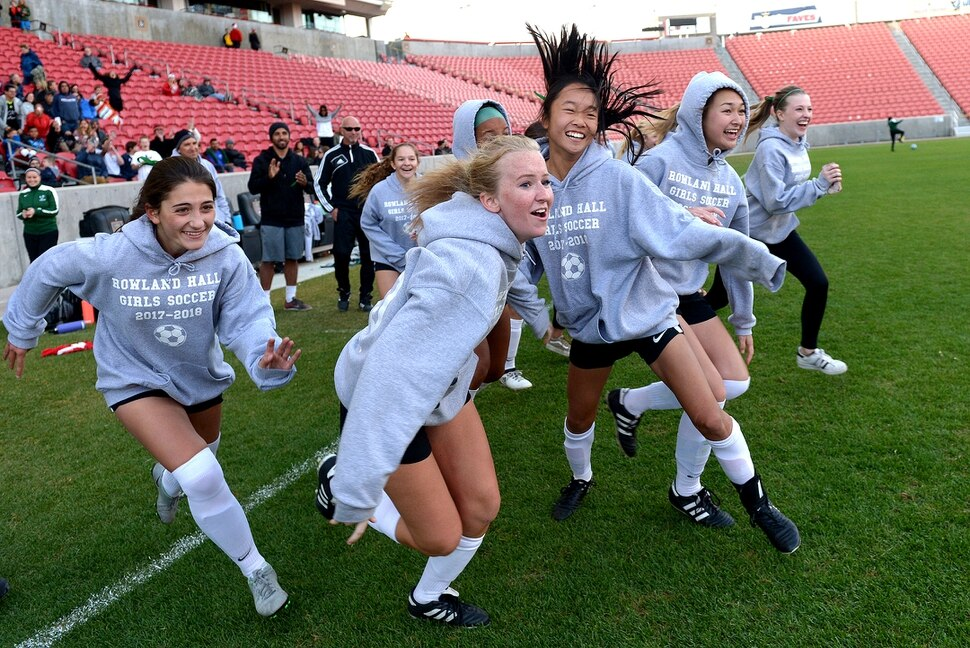 (Leah Hogsten | The Salt Lake Tribune) The starters explode from the sidelines to celebrate the win with their teammates. Rowland Hall women's soccer team defeated Waterford 6-3 to win the Class 2A girls' soccer state title game, Saturday, October 21, 2017 at Rio Tinto Stadium.