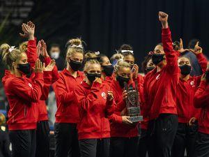 (Rick Egan | The Salt Lake Tribune) Utah celebrates with the PAC-12 Gymnastics Championship trophy at the Maverik Center, on Saturday, March 20, 2021.