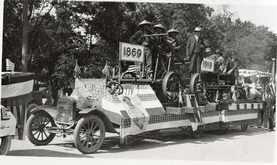 (Photo courtesy Stewart Library, Special Collections) Men who worked on the transcontinental railroad in 1869 ride on a float in 1919. Photographs taken during the Ogden parade are featured in