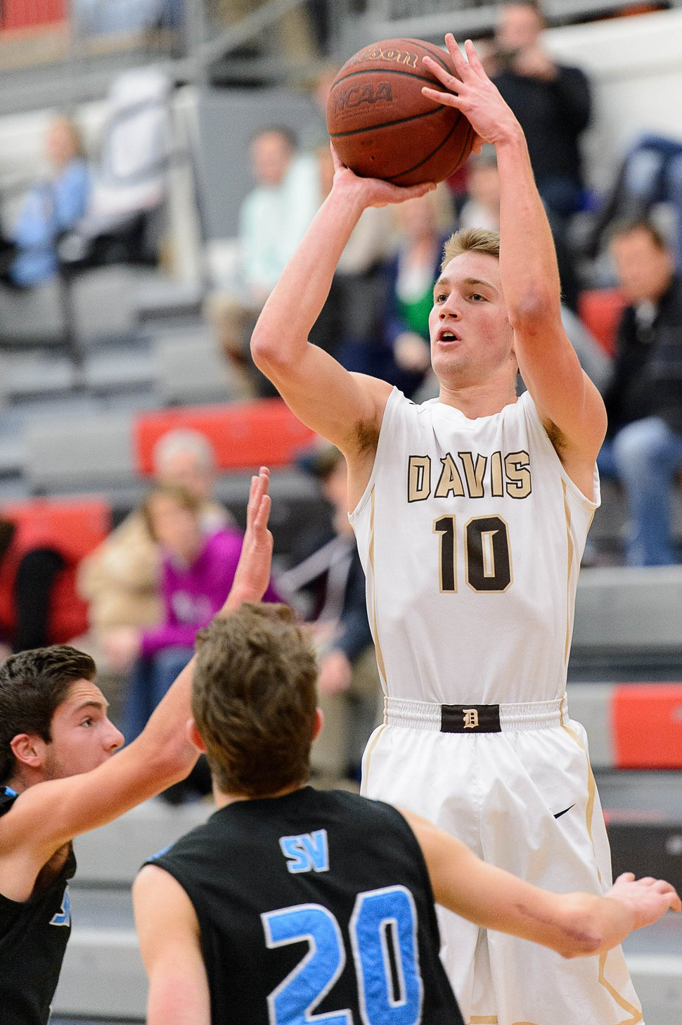 Trent Nelson | The Salt Lake Tribune Davis's Jesse Wade puts up a shot as Sky View faces Davis High School in the championship game of the Utah Elite 8 basketball tournament in American Fork, Saturday December 13, 2014.