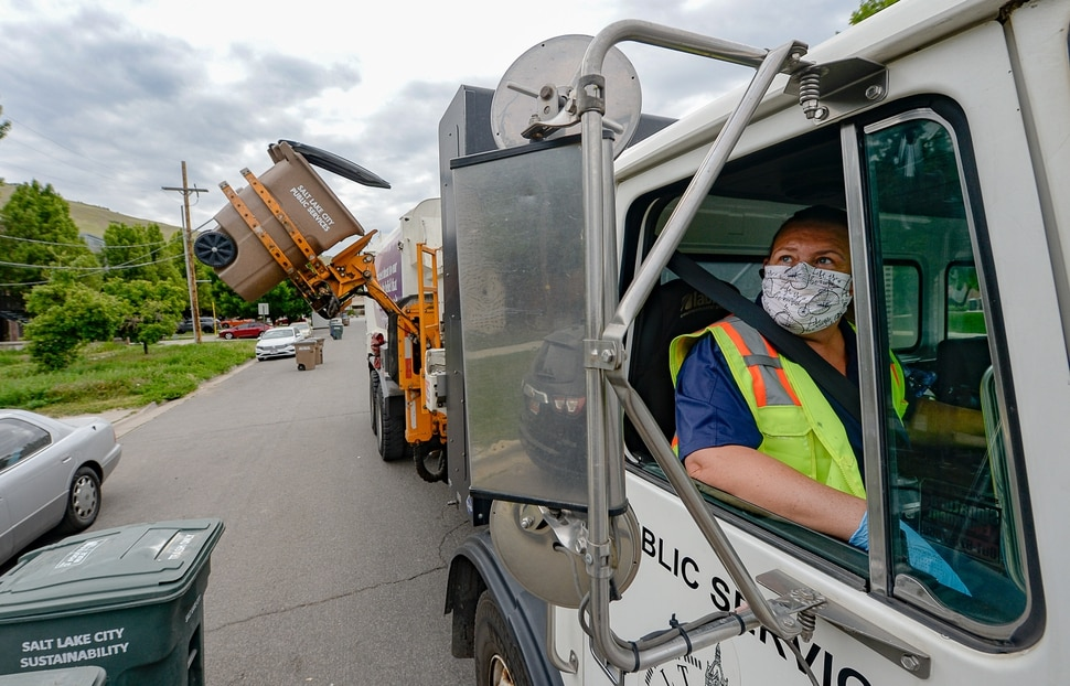 (Francisco Kjolseth | The Salt Lake Tribune) Tammy Scown joins the parade of trucks picking up yard waste, garbage and recycling as they work through the northwest quadrant in Salt Lake City on Friday, May 15, 2020.