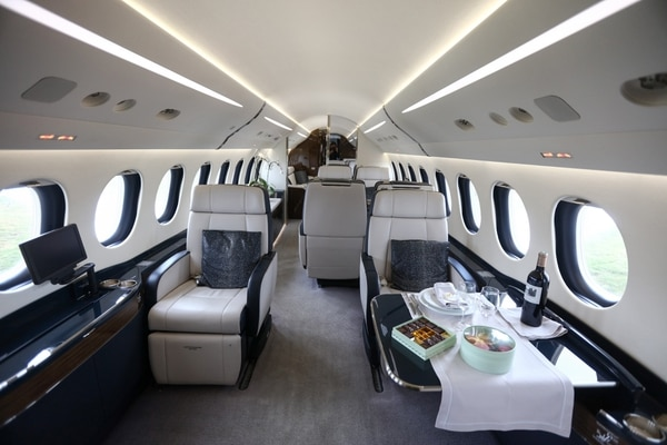 (Simon Dawson   Bloomberg) A table setting for a meal sits inside a Falcon 7X business jet, manufactured by Dassault Aviation SA.