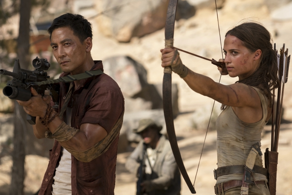 This image released by Warner Bros. Pictures shows Daniel Wu, left, and Alicia Vikander in a scene from