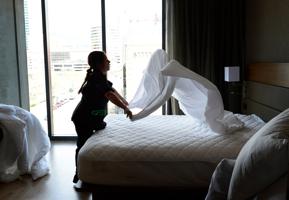 (Scott Sommerdorf | The Salt Lake Tribune) Leticia Longoria changes a corner room's linen at the new AC Hotel in downtown Salt Lake City, Friday, April 20, 2018. Hotels and other lodging properties had 11 percent more employees last month than in the previous March, helping to lead Utah to a 3.3 percent year-over-year job growth rate, the best in the nation.