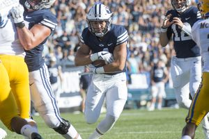 (Rick Egan     The Salt Lake Tribune)    Brigham Young Cougars running back Lopini Katoa (4) scores his first of two second quarter touchdowns, in football action Brigham Young Cougars vs McNeese State Cowboys at LaVell Edwards Stadium, Saturday, Sept. 22, 2018.