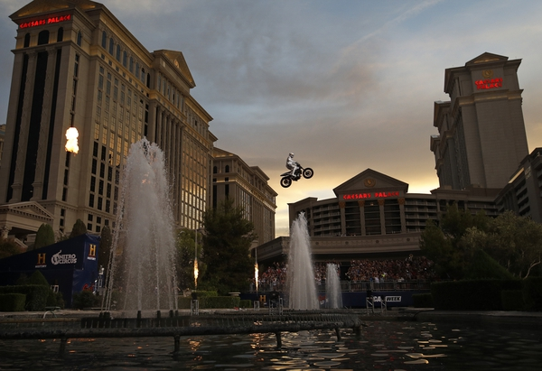 Travis Pastrana jumps the fountain at Caesars Palace on a motorcycle Sunday, July 8, 2018, in Las Vegas. Pastrana recreated three of Evel Knievel's iconic motorcycle jumps on Sunday, including the leap over the fountains of Caesars Palace that left Knievel with multiple fractures and a severe concussion. (AP Photo/John Locher)