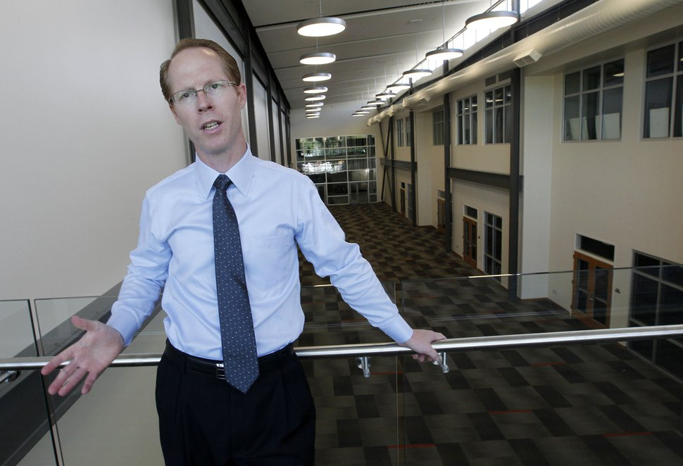 (Al Hartmann | The Salt Lake Tribune ) Ex-principal Ken Grover shows the atrium area of Innovations Early College High School, at 1700 South and State Street, as seen when the school was opening in 2012. Polices at the hybrid high school are under review over alleged improprieties in how Grover, who also headed the district's career and training services, spent districtwide funds for the benefit of Innovations High students.