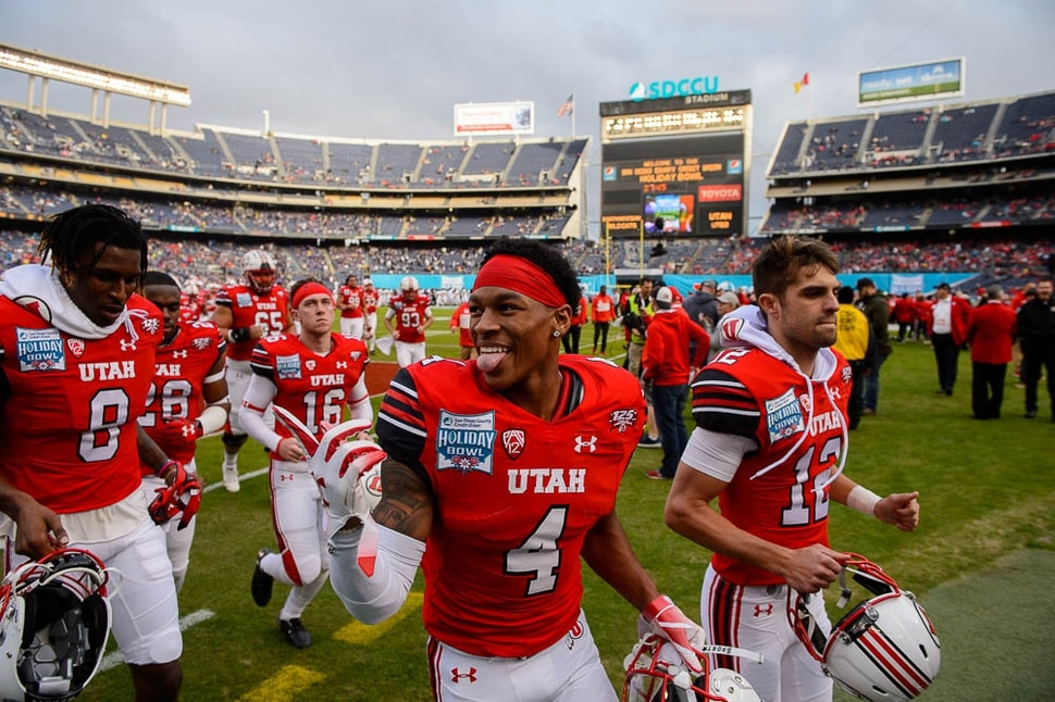 (Trent Nelson | The Salt Lake Tribune) The University of Utah prepares to face Northwestern in the Holiday Bowl, NCAA football in San Diego, Calif., on Monday Dec. 31, 2018. Utah Utes running back TJ Green (4) at center