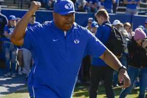 (Leah Hogsten     The Salt Lake Tribune) Brigham Young Cougars head coach Kalani Sitake takes the field at LaVell Edwards Stadium on Nov. 16, 2019. BYU on Tuesday extended Sitake's contract through the 2025 season.