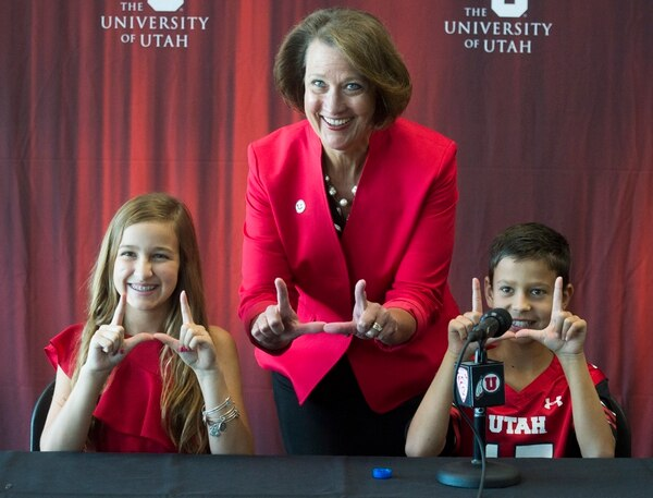 (Rick Egan | The Salt Lake Tribune) University of Utah President Ruth V. Watkins poses with Mark Harlan, the new athletic director's children Savanah 13, and Austin, 10, during a news conference at the Rice-Eccles Stadium, Monday, June 4, 2018.