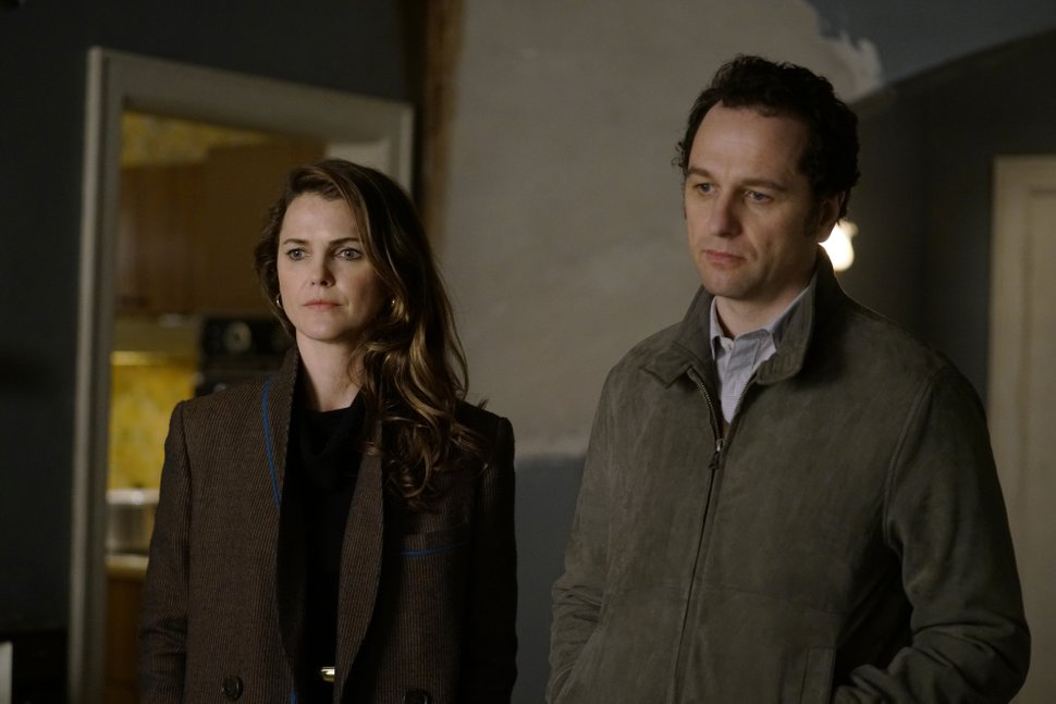 This image released by FX shows Keri Russell, left, and Matthew Rhys in a scene from