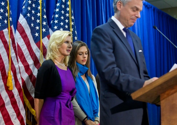 Republican presidential candidate and former Utah Gov. Jon Huntsman announces his withdrawal from the race, Monday, Jan. 16, 2012, in Myrtle Beach, S.C., as his wife, Mary Kaye, left, and daughter Abby listen. (AP Photo/David Goldman)