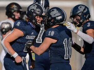 (Trent Nelson  |  The Salt Lake Tribune) Corner Canyon's Jaxson Dart celebrates with Austin Bell (10) and Cody Hagen (3) at the end of the 6A state football championship game against Lone Peak at Cedar Valley High School in Eagle Mountain on Friday, Nov. 20, 2020.