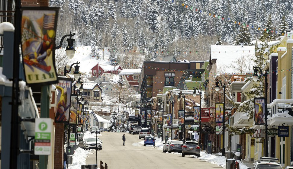 (Leah Hogsten | The Salt Lake Tribune) People walk Main Street in Park City, Friday, Mar. 27, 2020. After seeing a surge of coronavirus cases, Summit County has issued an order for all residents to not leave their homes unless necessary Ñ amid calls for the state and other counties to take similar action. The shelter-in-place restriction, which is the first in Utah, will start Friday at midnight.