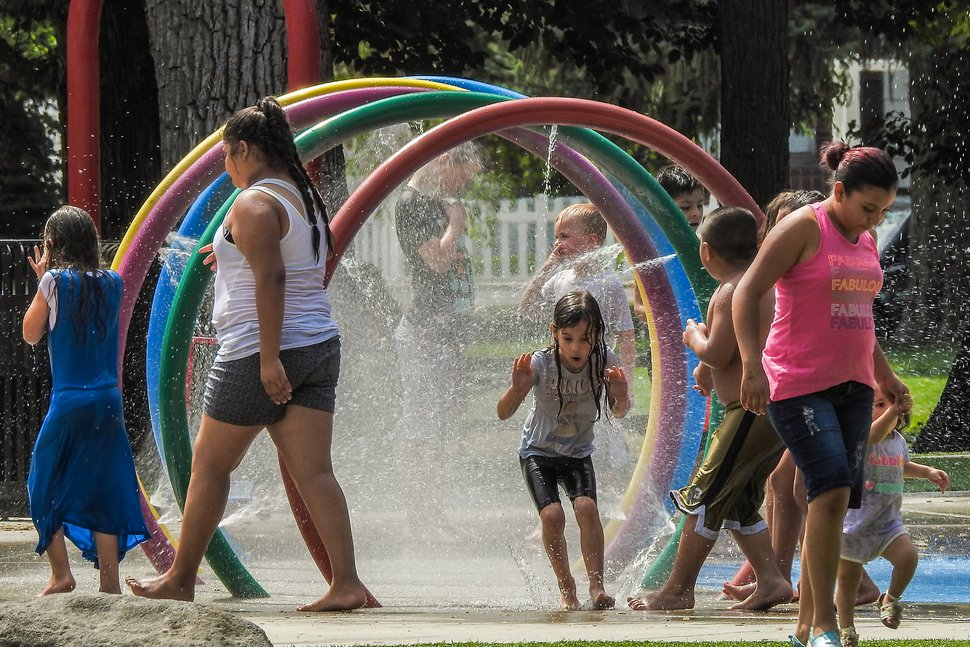 Chris Detrick | The Salt Lake Tribune Children play in the splash pad in Rotary Playground at Liberty Park Wednesday, July 12, 2017.