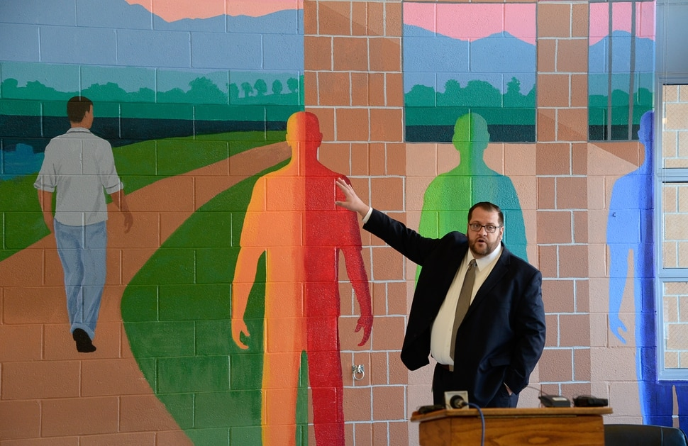 (Francisco Kjolseth | The Salt Lake Tribune) Juvenile Justice Services Director Brett Peterson at Decker Youth Center in West Valley City describes a mural in the multipurpose room meant to illustrate the positive transformation of youth working through the juvenile justice system. Peterson gave a tour on Wednesday, Jan. 15, 2020, to discuss its success after juvenile justice reforms were passed in 2017. Gov. Gary Herbert was on hand to tour the facility and speak with some of the youth who are being held at the facility.