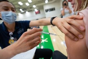 (Francisco Kjolseth | The Salt Lake Tribune) Registered nurse Yazmin Tovar gives Taylor Hilmo, 16, her first dose shot of the Pfizer vaccine as people are vaccinated against COVID-19 at the former Provo High School at 1125 N. University Ave. on Wednesday, July 28, 2021.