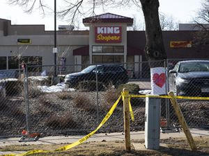 (Eliza Earle | The New York Times) A heart drawing inside fencing that surrounds the parking lot outside a King Soopers grocery store in Boulder, Colo., on Tuesday, March 23, 2021, following Monday's shooting, which left 10 people dead including a police officer.