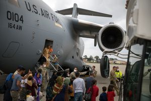 (Gordon Welters | The New York Times) A C-17 aircraft arrives with some of the final people evacuated from Afghanistan, at Ramstein Air Base in Germany, Monday, Aug. 30, 2021.