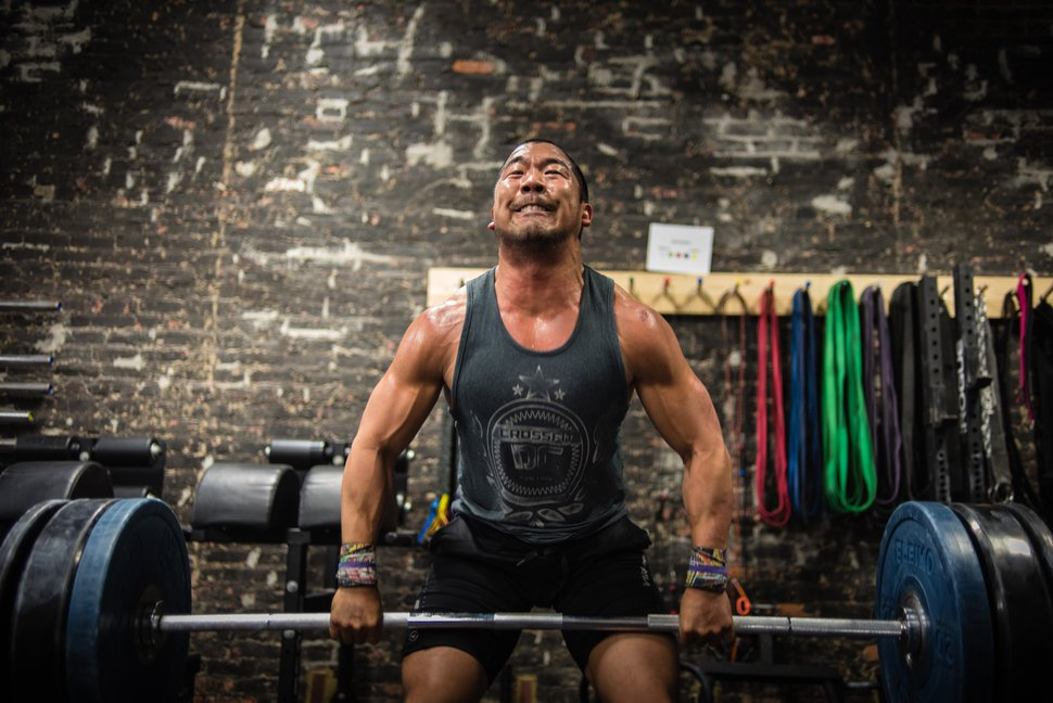 (Andre Chung | The Washington Post) Tyler Downing, who has been doing Crossfit for four years, works out at Crossfit DC.